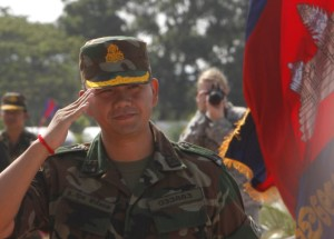 "A Cambodian Prime Minister Hun Sen's son LTG. Hun Manet, Deputy Commender of the Royal Cambodian Army and Commender of the National Counter Terror Special Force, walks through honorary guards as his arrives for presiding over a U.S.-backed peacekeeping exercise dubbed ""Angkor Sentinel 2014"" at the Cambodian tank command headquarters in Kampong Speu province, 60 kilometers (37 miles) west of Phnom Penh, Cambodia, Monday, April 21, 2014. The U.S. and Cambodia on Monday commenced Angkor Sentinel, an annual military exercise designed to promote regional peace and security, release reported. (AP Photo/Heng Sinith)"